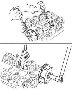Затягивание болта крепления звездочки распредвала (обычный двигатель) и исполнительного механизма изменения фаз газораспределения