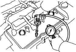 Установка компрессометра в отверстие свечи зажигания