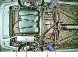 Расположение узлов системы выпуска отработавших газов в задней части автомобиля