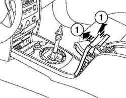 Отсоединение облицовки рукоятки привода стояночного тормоза