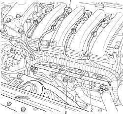 Расположение на двигателе датчика (1) температуры поступающего воздуха, топливораспределительной рампы (2), датчика детонации (3)